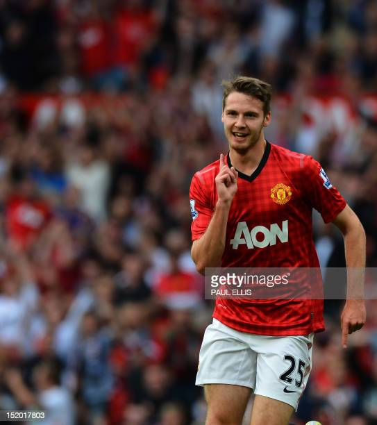 Manchester United's English midfielder Nick Powell celebrates scoring his goal during the English Premier League football match between Manchester...