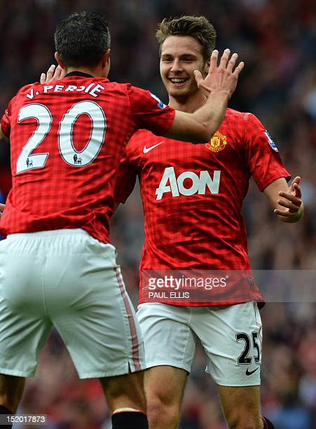 Manchester United's English midfielder Nick Powell celebrates scoring his goal with Dutch striker Robin Van Persie during the English Premier League...