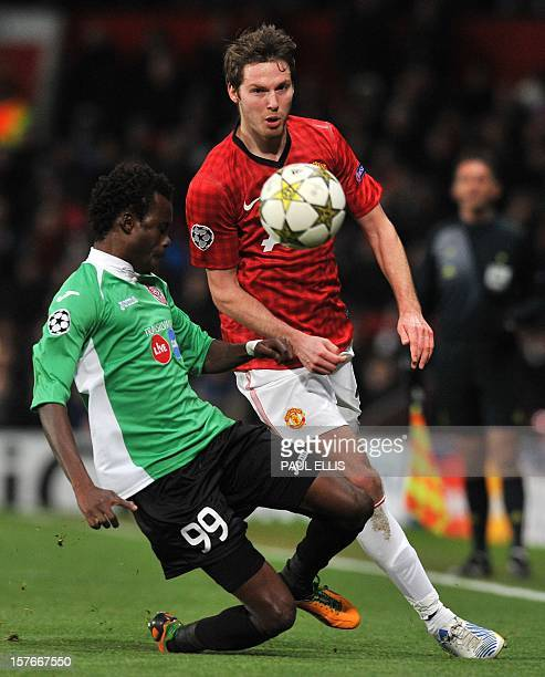 Manchester United's English midfielder Nick Powell vies with Cluj's Senegalese forward Modou Sougou during the UEFA Champions League group H football...