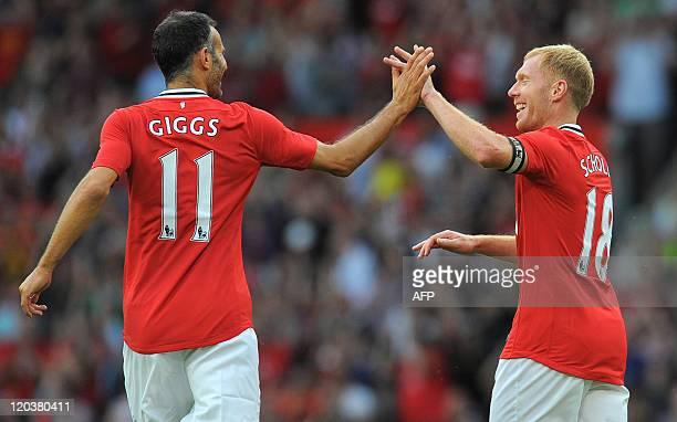 Manchester United's English midfielder Paul Scholes celebrates with Manchester United's Welsh midfielder Ryan Giggs after scoring during the Paul...