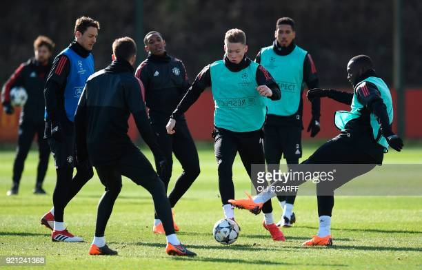 Manchester United's English midfielder Scott McTominay and Manchester United's Belgian striker Romelu Lukaku take part in a team training session at...