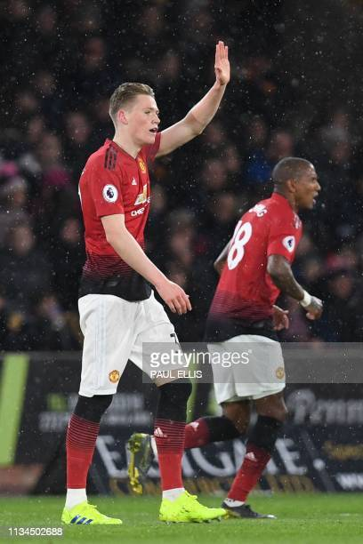 Manchester United's English midfielder Scott McTominay celebrates scoring the opening goal during the English Premier League football match between...