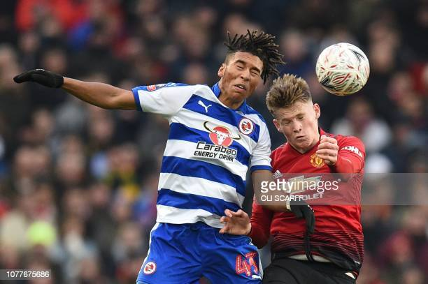 Manchester United's English midfielder Scott McTominay goes up with Reading's English striker Danny Loader for a header during the English FA Cup...