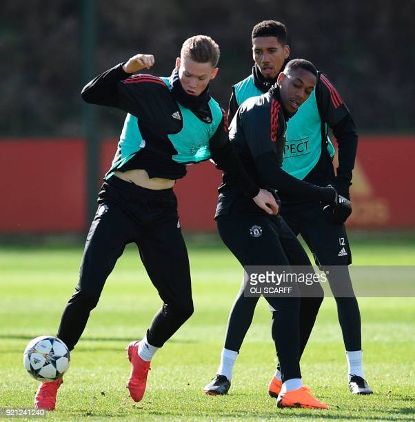 Manchester United's English midfielder Scott McTominay Manchester United's English defender Chris Smalling and Manchester United's French striker...