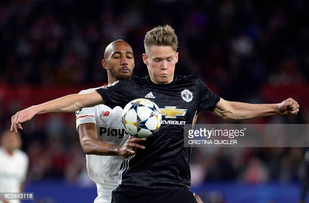 Manchester United's English midfielder Scott McTominay vies for the ball with Sevilla's French midfielder Steven N'Zonzi during the UEFA Champions...