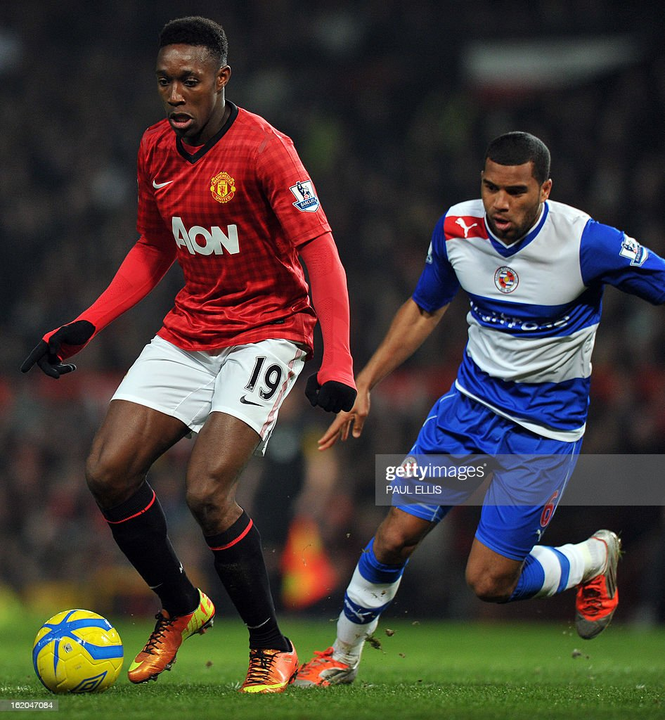 """Manchester United's English striker Danny Welbeck (L) holds the ball from Reading's Jamaican defender Adrian Mariappa (R) during the English FA Cup fifth round football match between Manchester United and Reading at Old Trafford in Manchester, north west England, on February 18, 2013. USE. No use with unauthorized audio, video, data, fixture lists, club/league logos or """"live"""" services. Online in-match use limited to 45 images, no video emulation. No use in betting, games or single club/league/player publications."""