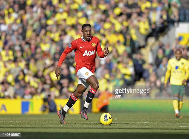 Manchester United's English striker Danny Welbeck runs with the ball during their English Premier League football match against Manchester United at...