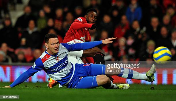 Manchester United's English striker Danny Welbeck shoots past Reading's English defender Sean Morrison during the English FA Cup fifth round football...