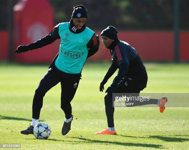 Manchester United's English striker Marcus Rashford and Manchester United's English midfielder Ashley Young take part in a team training session at...