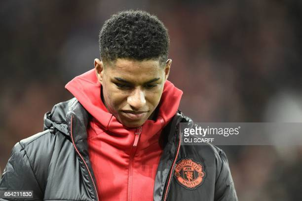 Manchester United's English striker Marcus Rashford arrives to take his place on the substitutes bench during the UEFA Europa League round of 16...