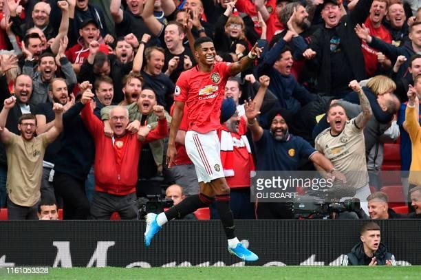 Manchester United's English striker Marcus Rashford celebrates after scoring their third goal during the English Premier League football match...