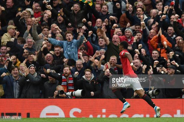 Manchester United's English striker Marcus Rashford celebrates after scoring the opening goal of the English Premier League football match between...