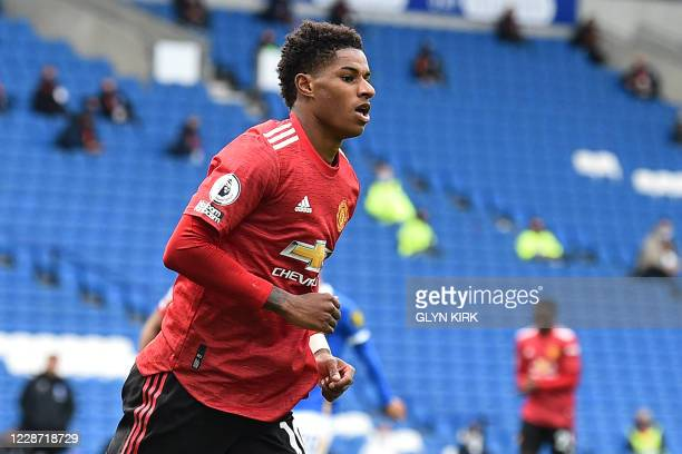 Manchester United's English striker Marcus Rashford celebrates after he scores his team's second goal during the English Premier League football...