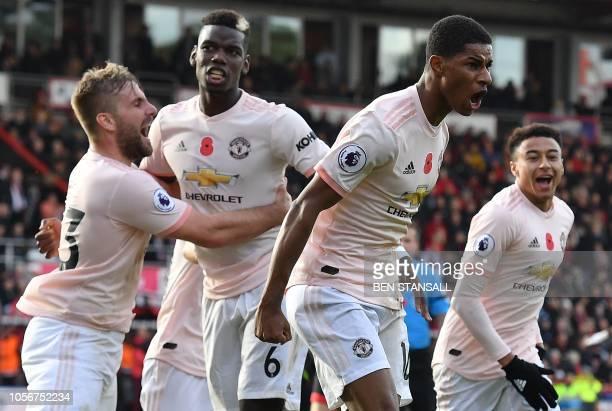 Manchester United's English striker Marcus Rashford celebrates scoring his team's second goal during the English Premier League football match...