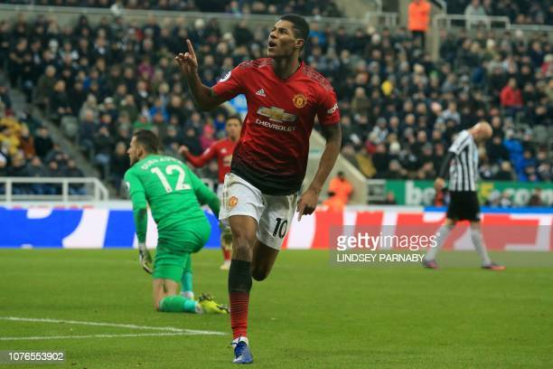 Manchester United's English striker Marcus Rashford celebrates scoring his team's second goal during the English Premier League football match...