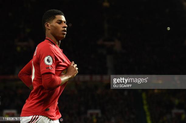 Manchester United's English striker Marcus Rashford celebrates scoring their second goal during the English Premier League football match between...