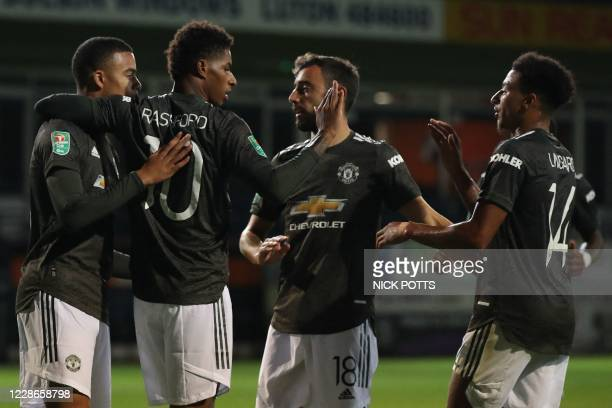 Manchester United's English striker Marcus Rashford celebrates scoring his team's second goal during the English League Cup third round football...