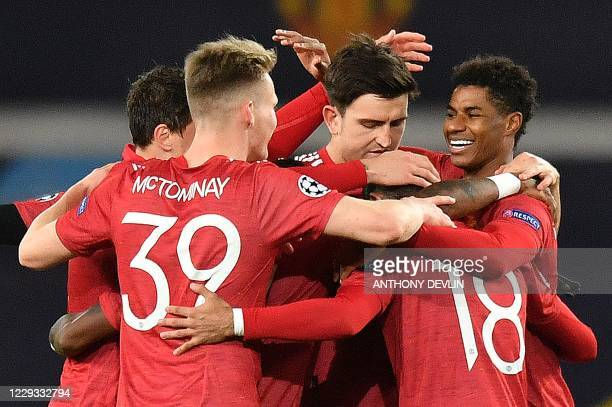Manchester United's English striker Marcus Rashford celebrates scoring his team's second goal during the UEFA Champions league group H football match...