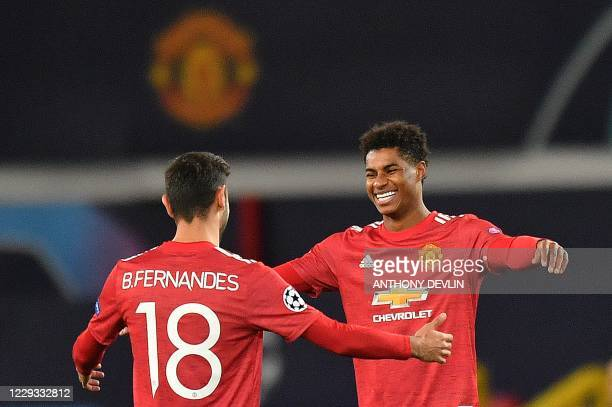 Manchester United's English striker Marcus Rashford celebrates scoring his team's third goal, his second, with Manchester United's Portuguese...