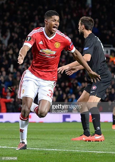 Manchester United's English striker Marcus Rashford celebrates scoring his team's second goal during the UEFA Europa League round of 32 second leg...
