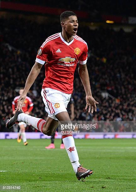 Manchester United's English striker Marcus Rashford celebrates scoring his team's third goal during the UEFA Europa League round of 32 second leg...