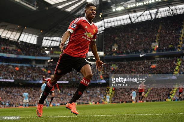 Manchester United's English striker Marcus Rashford celebrates scoring his team's first goal during the English Premier League football match between...