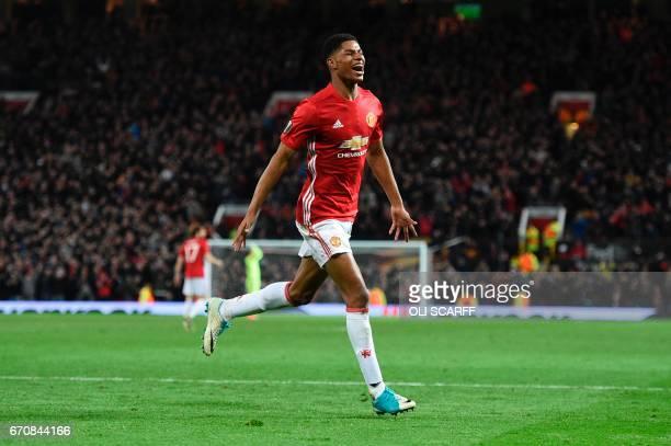 Manchester United's English striker Marcus Rashford celebrates scoring their second goal during the UEFA Europa League quarterfinal second leg...