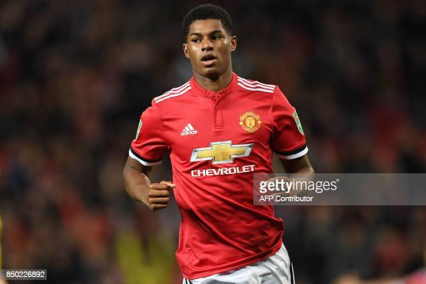 Manchester United's English striker Marcus Rashford celebrates scoring the opening goal during the English League Cup third round football match...