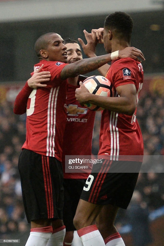 Manchester United's English striker Marcus Rashford (R) celebrates with Manchester United's English midfielder Ashley Young (L) after scoring during the English FA Cup fifth round football match between Blackburn Rovers and Manchester United at Ewood Park in Blackburn, north west England on February 19, 2017. / AFP / Oli SCARFF / RESTRICTED TO EDITORIAL USE. No use with unauthorized audio, video, data, fixture lists, club/league logos or 'live' services. Online in-match use limited to 75 images, no video emulation. No use in betting, games or single club/league/player publications. /