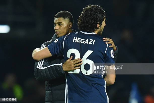 Manchester United's English striker Marcus Rashford consoles West Bromwich Albion's Egyptian defender Ahmed Hegazy after the English Premier League...