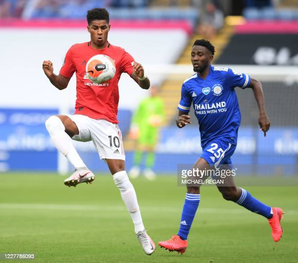 Manchester United's English striker Marcus Rashford controls the ball under pressure from Leicester City's Nigerian midfielder Wilfred Ndidi during...