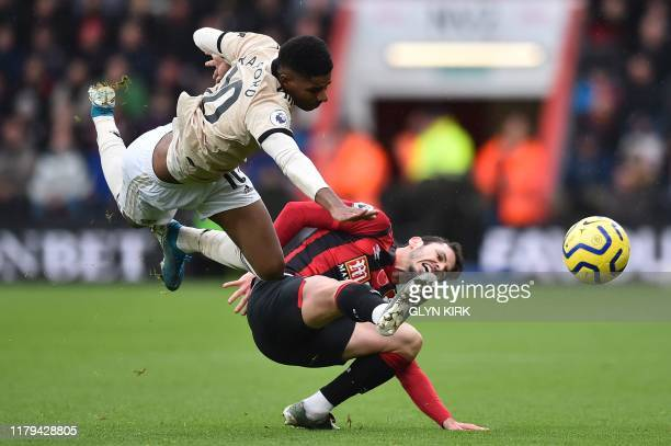 Manchester United's English striker Marcus Rashford goes for the ball against Bournemouth's English defender Adam Smith during the English Premier...