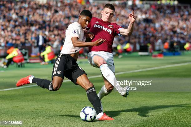 Manchester United's English striker Marcus Rashford goes to cross as West Ham United's Irish defender Declan Rice defends during the English Premier...