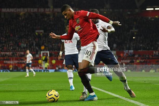 Manchester United's English striker Marcus Rashford is fouled by Tottenham Hotspur's French midfielder Moussa Sissoko for a penalty, converted by...