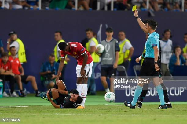 Manchester United's English striker Marcus Rashford is shown a yellow card by main referee Gianluca Rocchi during the UEFA Super Cup football match...