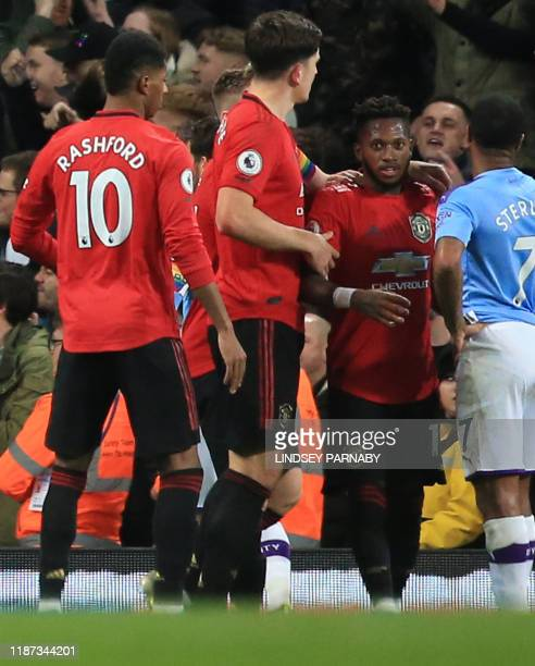 Manchester United's English striker Marcus Rashford Manchester United's English defender Harry Maguire and Manchester City's English midfielder...
