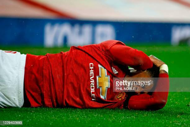 Manchester United's English striker Marcus Rashford reacts after picking up an injury during the English Premier League football match between...