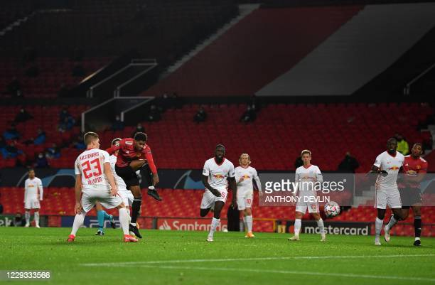 Manchester United's English striker Marcus Rashford scores his team's fifth goal his third making a hat trick during the UEFA Champions league group...