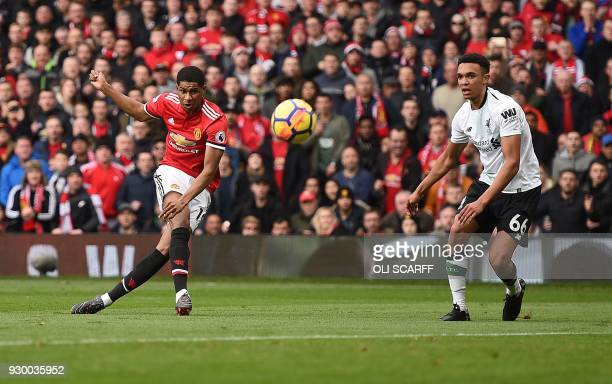 TOPSHOT Manchester United's English striker Marcus Rashford scores the opening goal during the English Premier League football match between...