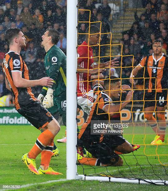 Manchester United's English striker Marcus Rashford scores their late winning goal during the English Premier League football match between Hull City...