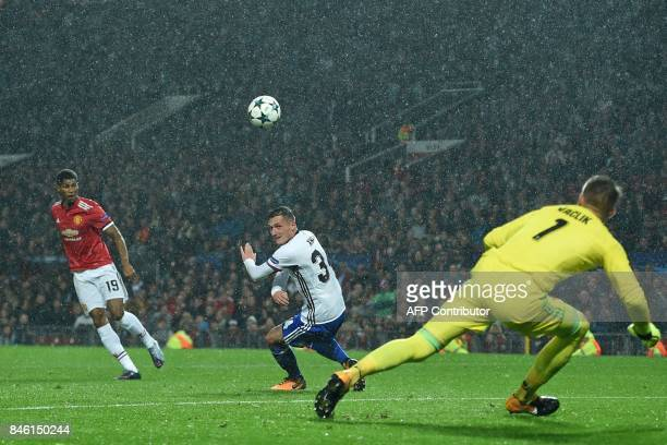 Manchester United's English striker Marcus Rashford scores their third goal during the UEFA Champions League Group A football match between...