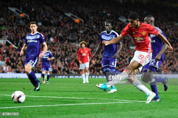 Manchester United's English striker Marcus Rashford shoots into the side netting during the UEFA Europa League quarterfinal second leg football match...