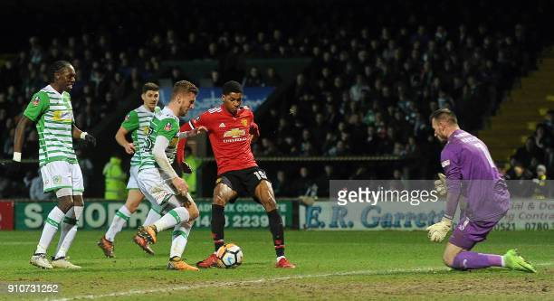 Manchester United's English striker Marcus Rashford shoots to score the opening goal past Yeovil Town's Polish goalkeeper Artur Krysiak during the FA...