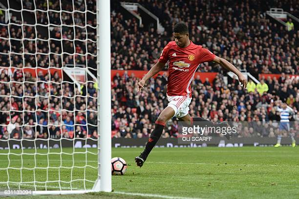 Manchester United's English striker Marcus Rashford slams the ball into an open net after dispossessing Reading's Omani goalkeeper Ali AlHabsi after...