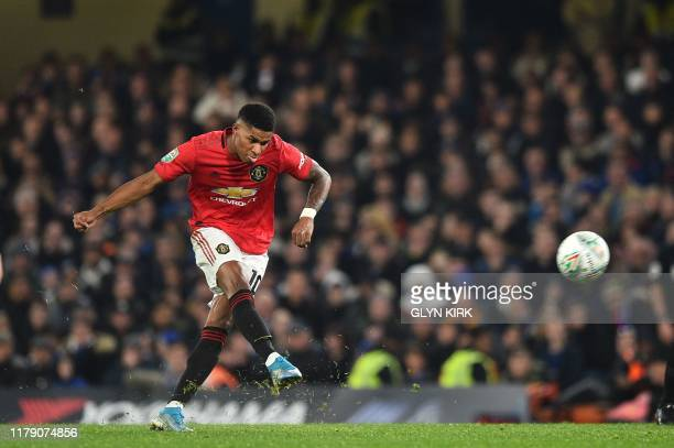 Manchester United's English striker Marcus Rashford takes a penalty and scores his team's second goal during the English League Cup fourth round...