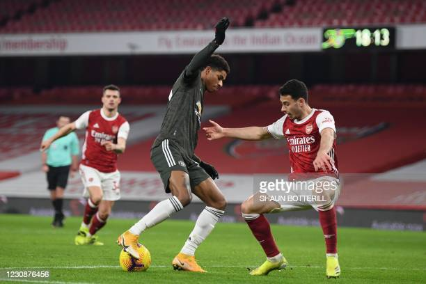 Manchester United's English striker Marcus Rashford takes on Arsenal's Brazilian striker Gabriel Martinelli during the English Premier League...
