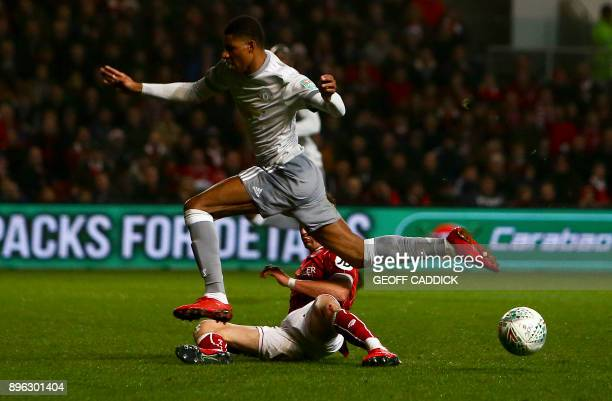 Manchester United's English striker Marcus Rashford vies for the ball with Bristol City's English midfielder Jamie Paterson during the English League...