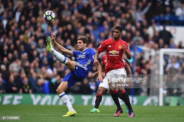 Manchester United's English striker Marcus Rashford vies with Chelsea's Spanish defender Marcos Alonso the English Premier League football match...