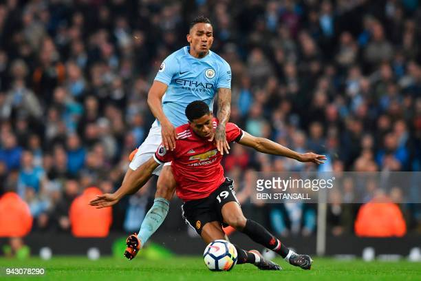 Manchester United's English striker Marcus Rashford vies with Manchester City's Brazilian defender Danilo during the English Premier League football...