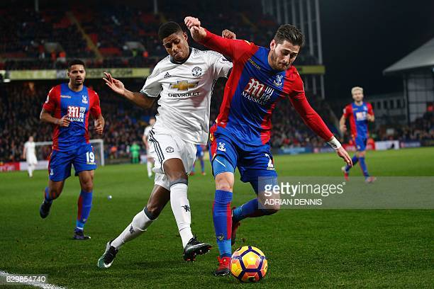Manchester United's English striker Marcus Rashford vies with Crystal Palace's English defender Joel Ward during the English Premier League football...